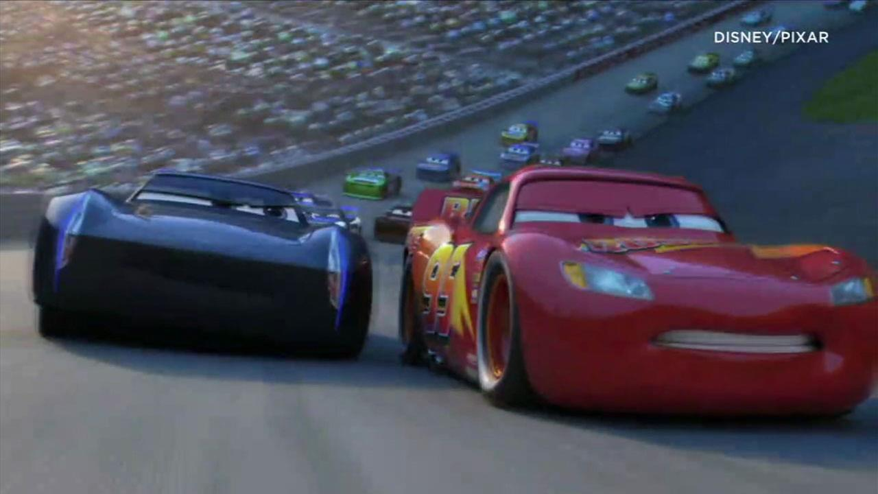 An image from Cars 3 shows Lightning McQueen racing against a new opponent.