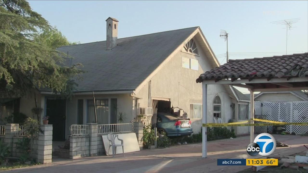 A child suffered major injuries after being struck by a car that plowed through a home in Colton Tuesday night.