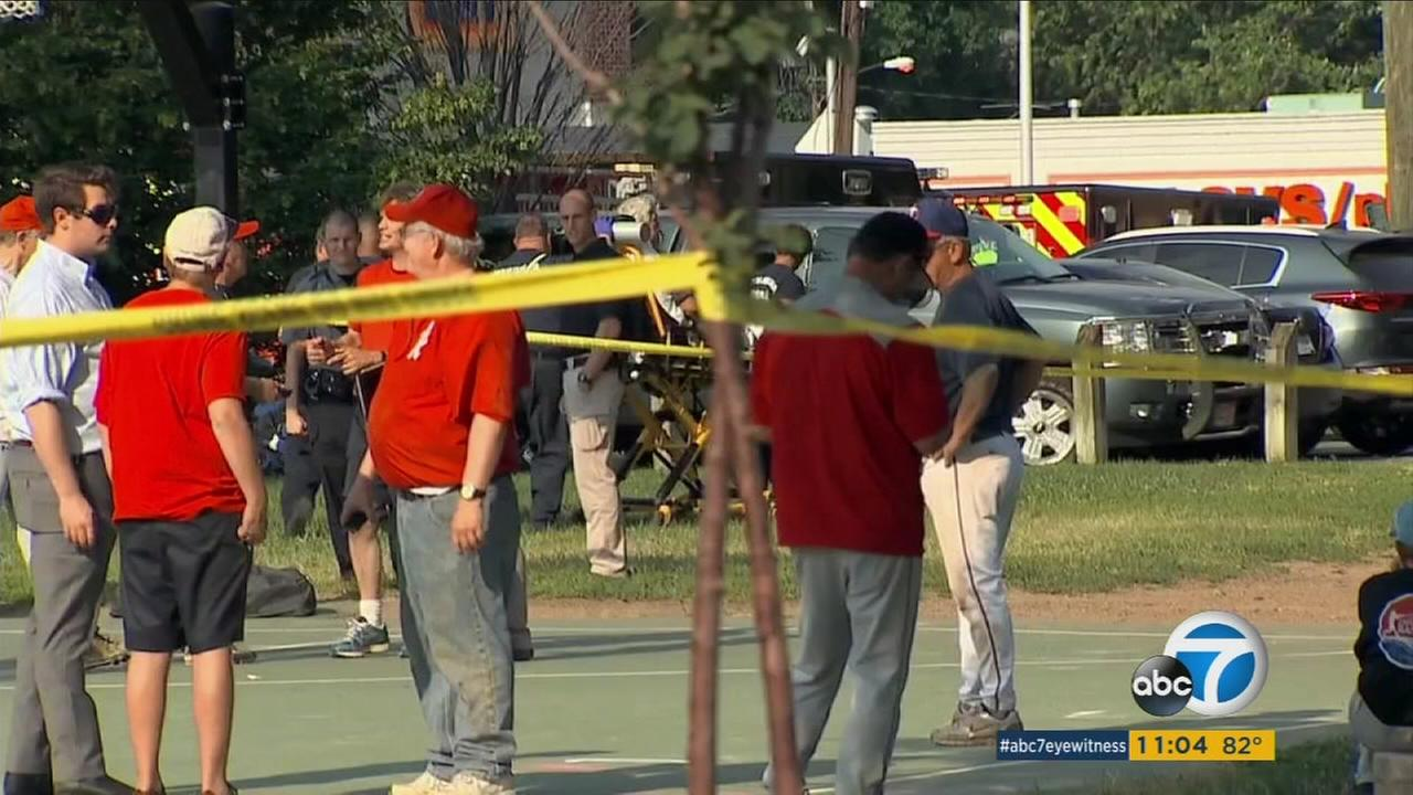 Rep. Joe Barton and other members of the Republican Congressional softball team stand behind police tape after a multiple shooting in Alexandria, Va., Wednesday, June 14, 2017.