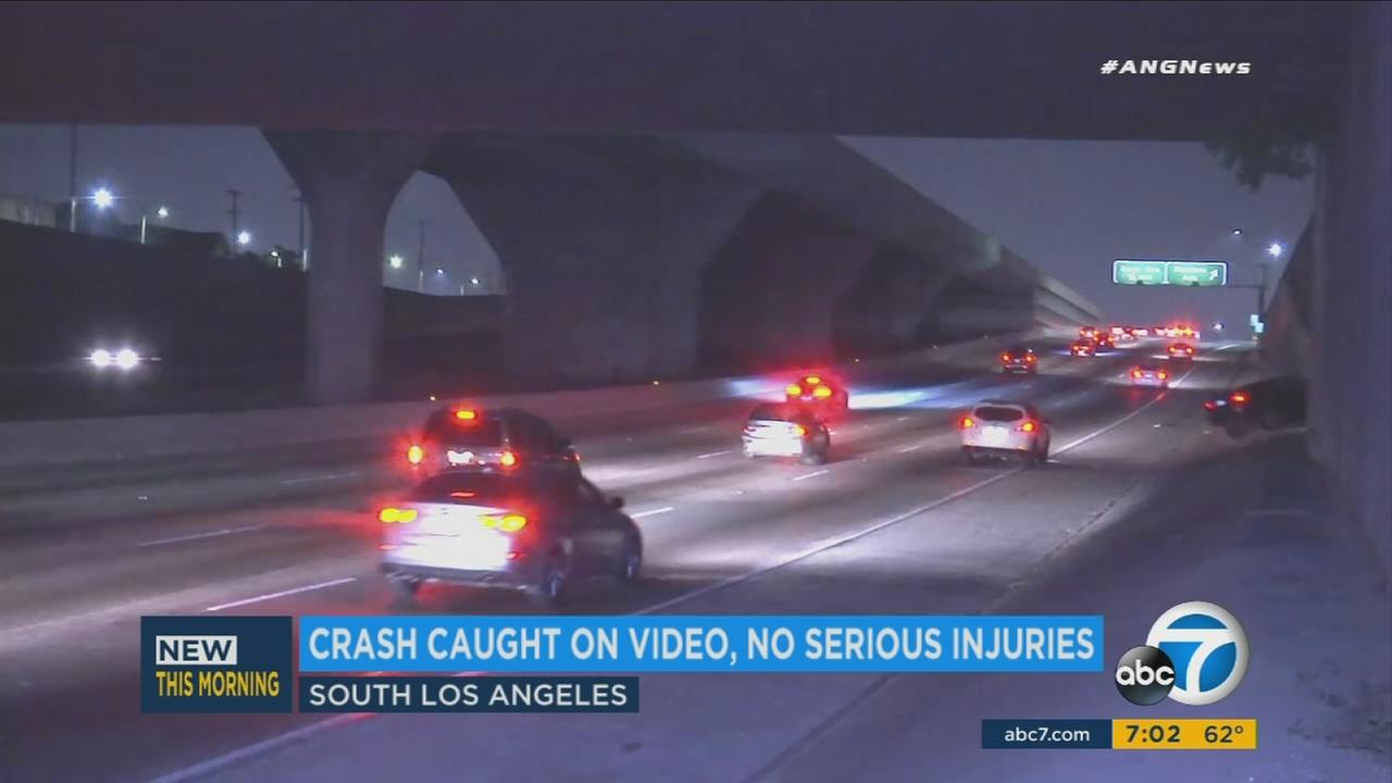 A wild car crash on the 110 Freeway in South Los Angeles early Sunday morning was caught on camera as it happened.
