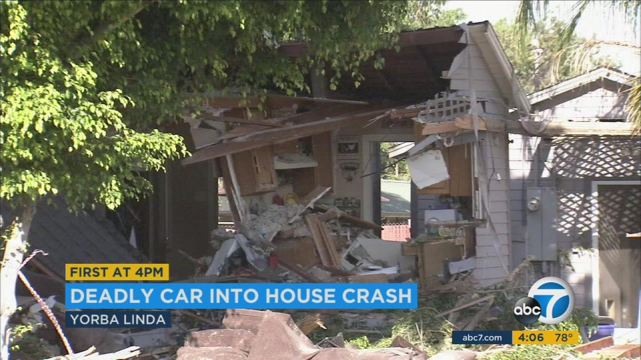 A house in Yorba Linda is partially destroyed after a vehicle plowed through it on Saturday, June 17, 2017.