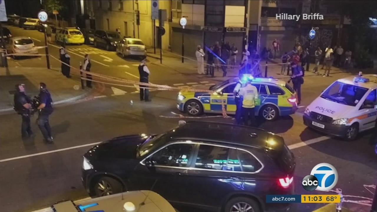 Authorities surround an area in north London after a driver struck a crowd outside a mosque on Monday, June 19, 2017.