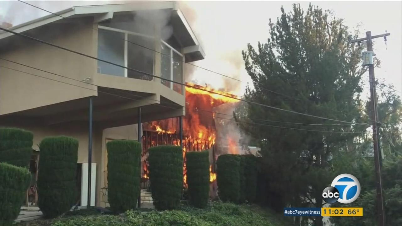 A home in Woodland Hills was engulfed in flames after a contractor hit a gas line, causing an explosion.
