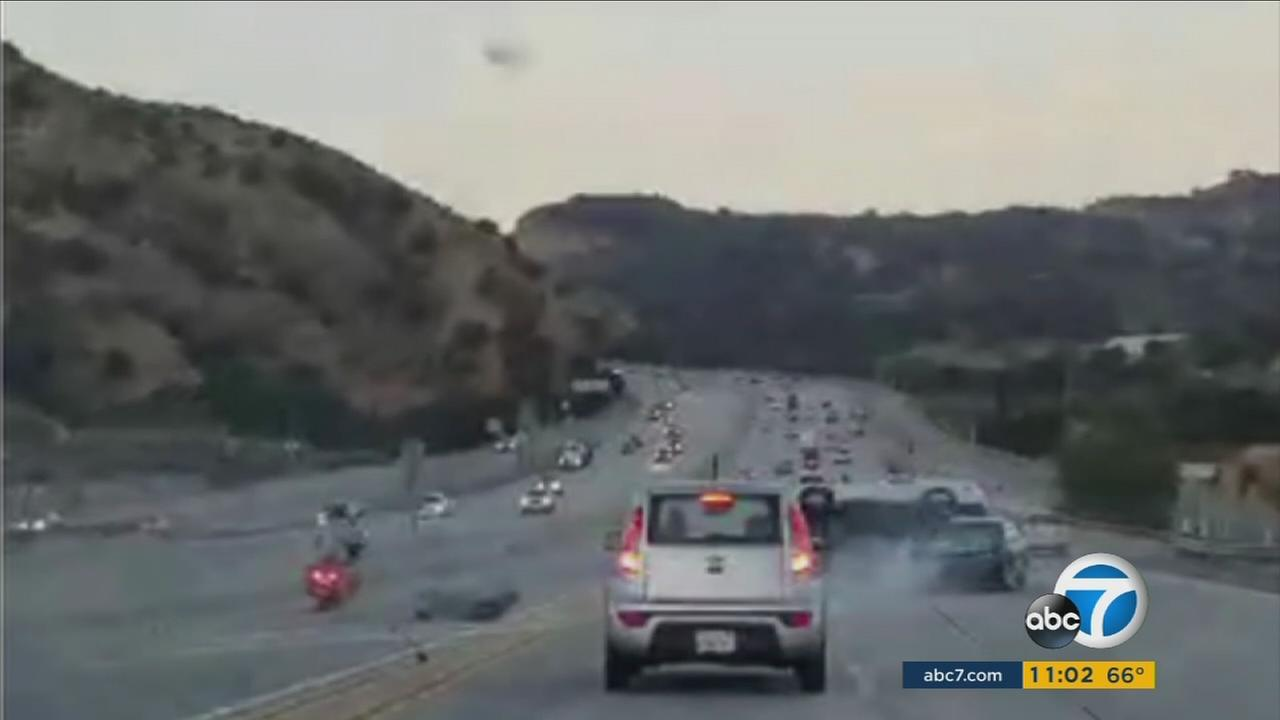 Video captures a wild chain-reaction crash after a man kicked a car on the 14 Freeway in Santa Clarita.