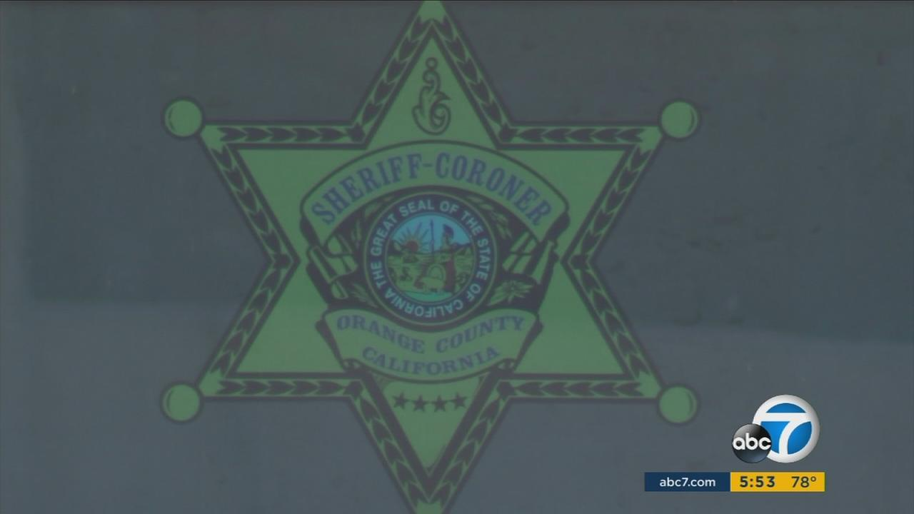 An image of the Orange County Sheriffs-Coroners Office is shown in a photo.