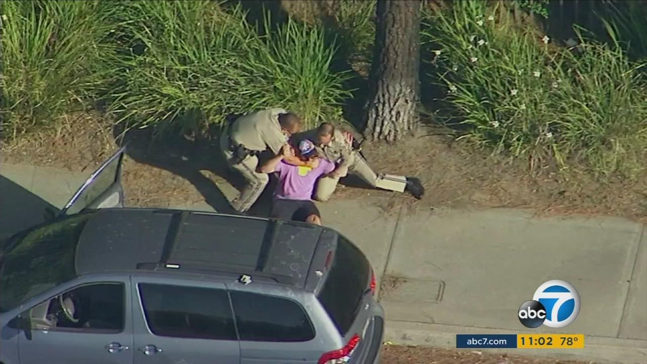 CHP officers had to wrestle a man to the ground after he was seen fighting with a woman in a minivan in Burbank.