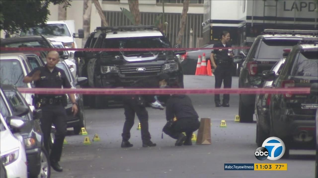 Police investigate the scene of a deadly officer-involved shooting in Hollywood on Friday, June 23, 2017.