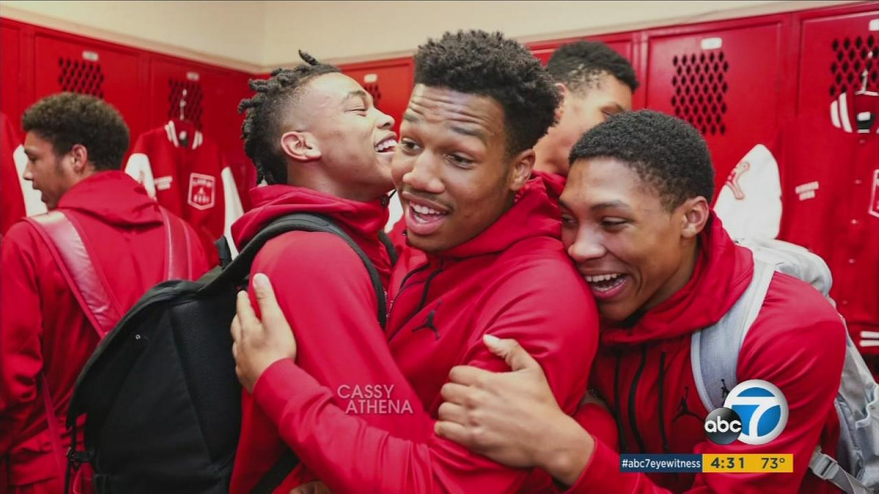 Redondo Beach High School Basketball Player Ryse Williams hugs teammates in the locker room. He died of a rare form of cancer a day before his school graduation ceremony.