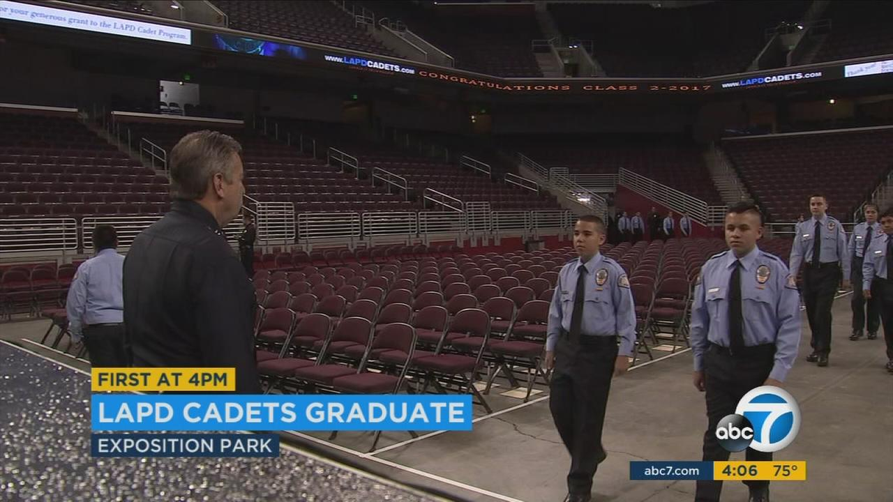 LAPD Chief Charlie Beck conducts an inspection of cadets as they graduate from the program.