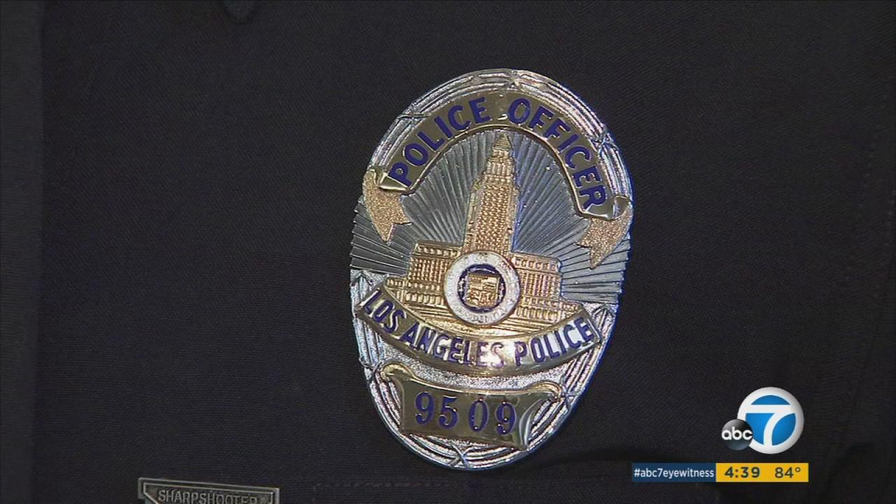 Two recent graduates of the Los Angeles Police Department received the exact same badge numbers and division assignments as their retired fathers.