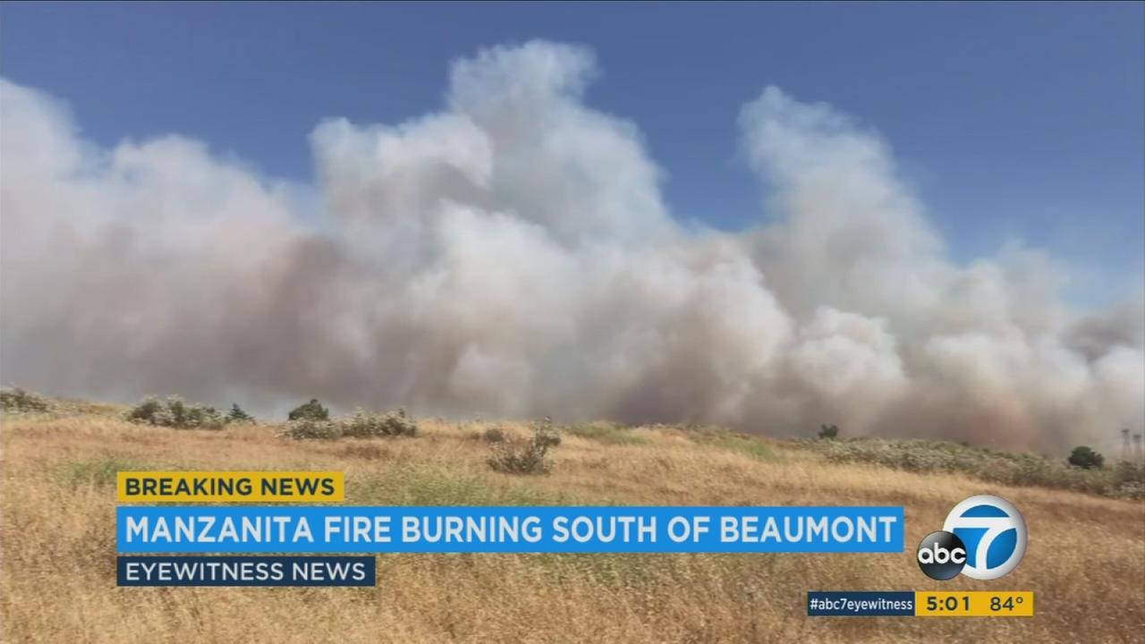 Smoke surrounds an area south of Beaumont, where a brush fire is burning on Monday, June 26, 2017.