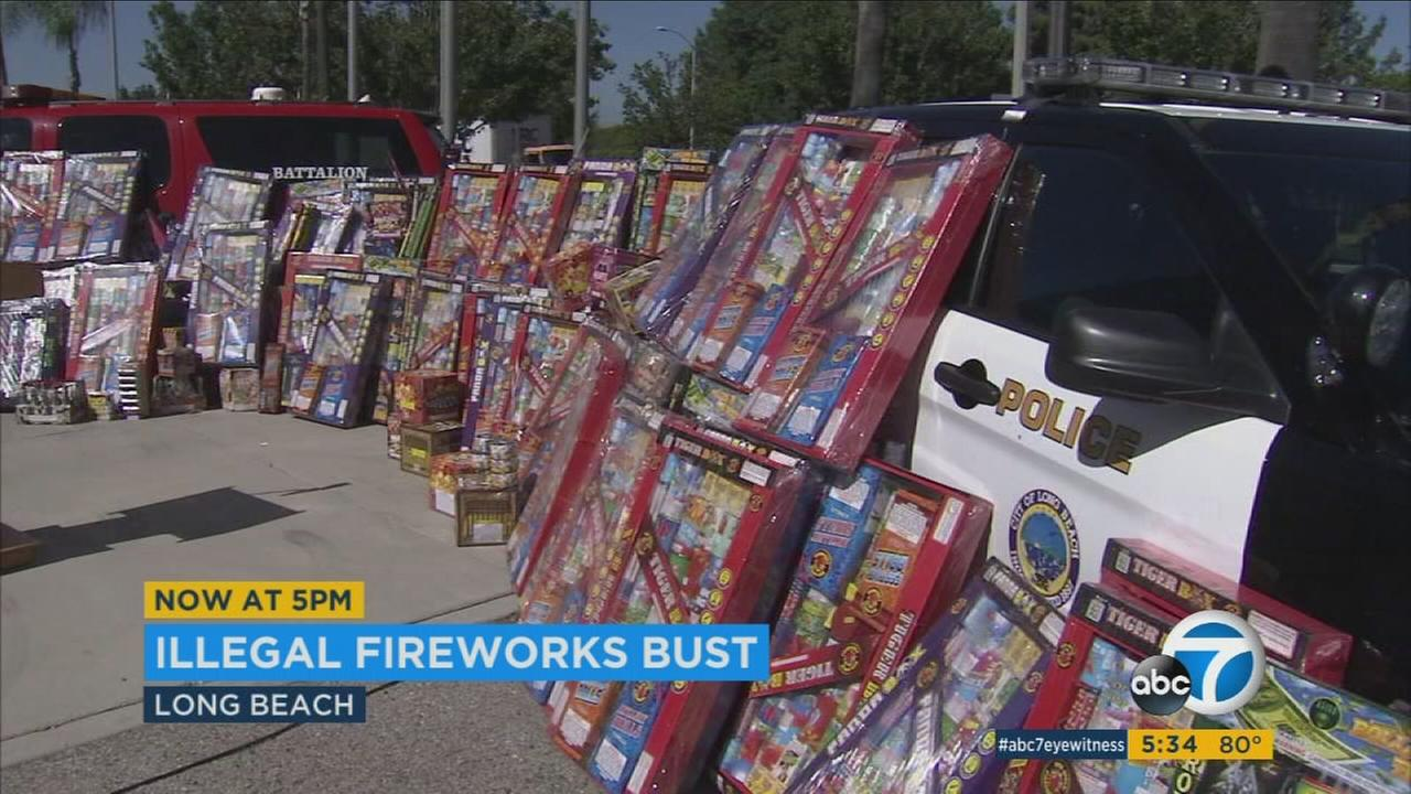 Long Beach officials arrested two known male gang members and a woman for allegedly trying to sell 5,000 pounds of illegal fireworks in a makeshift storefront out of a garage.