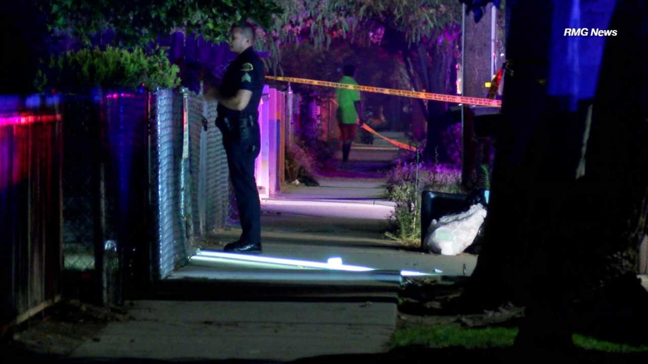 A law enforcement officer officer investigates the scene of a fatal shooting in Pomona.