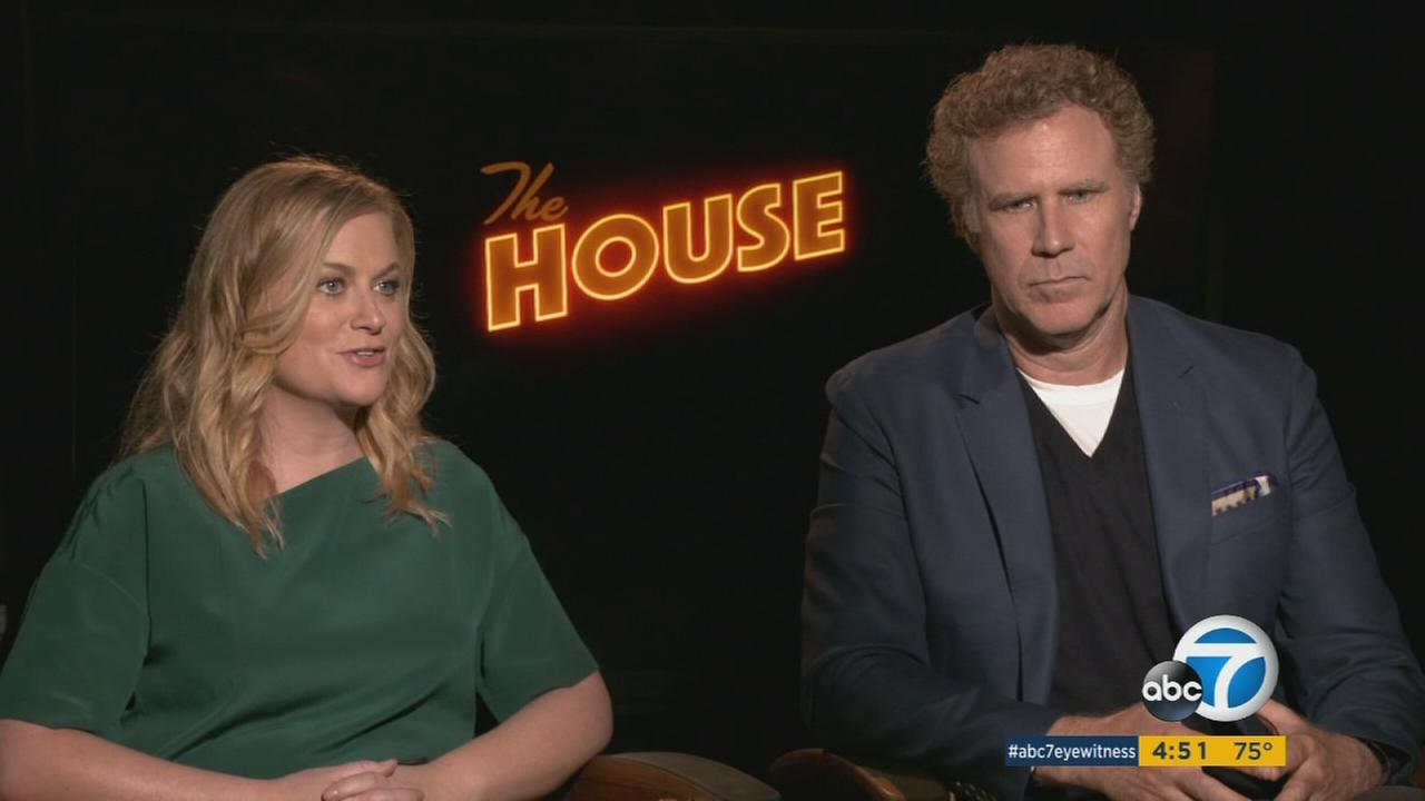 Amy Poehler and Will Ferrell talk during an interview for their new comedy The House.