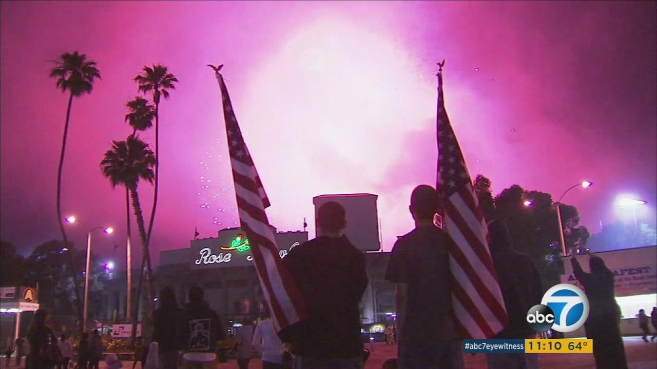 Spectators watch a fireworks show at the Pasadena Rose Bowl.