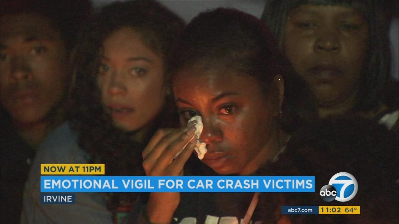 An emotional candlelight vigil was held in Irvine to honor the memories of two young men killed in a fiery car crash.