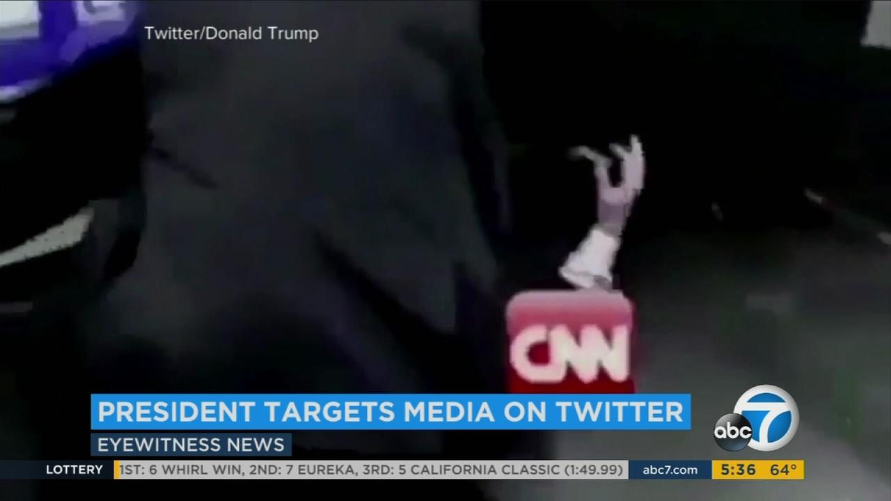 President Donald Trump wrestles with CNN in a mock video.