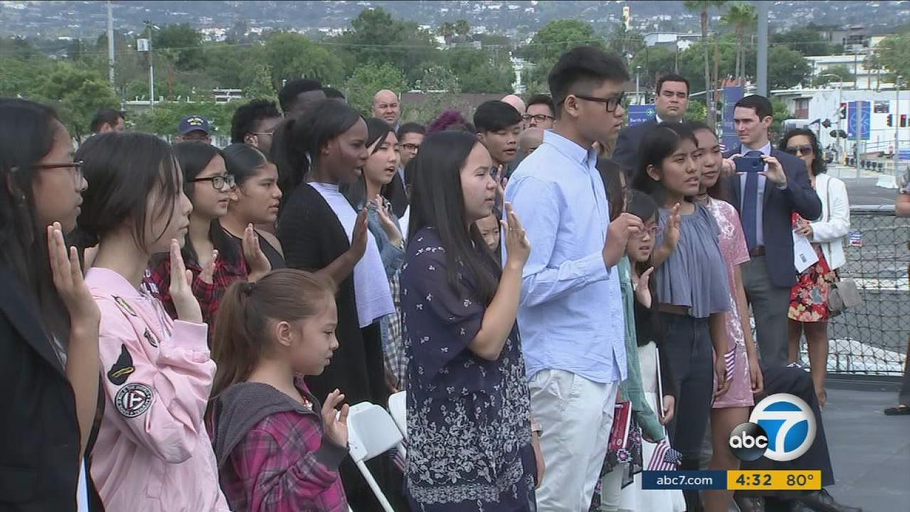 Dozens of Southern California kids were sworn in as citizens on the USS Iowa in San Pedro just in time to celebrate Independence Day as Americans.