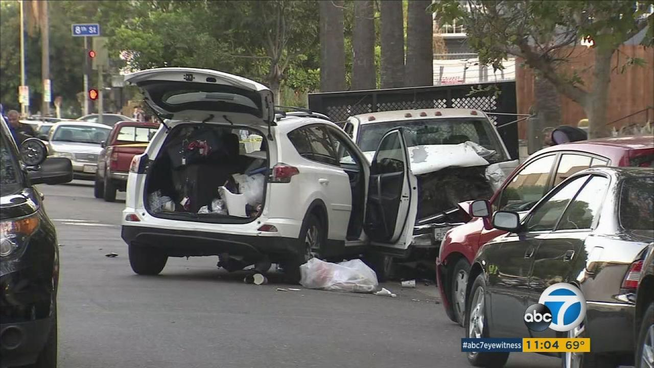 Two people were killed after a truck crashed into parked cars in Koreatown Wednesday.