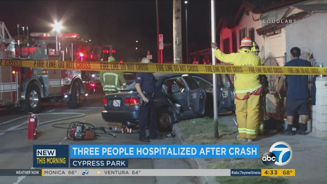 Three people were hospitalized on Friday after a vehicle slammed into a parked car and a brick fence in Cypress Park.