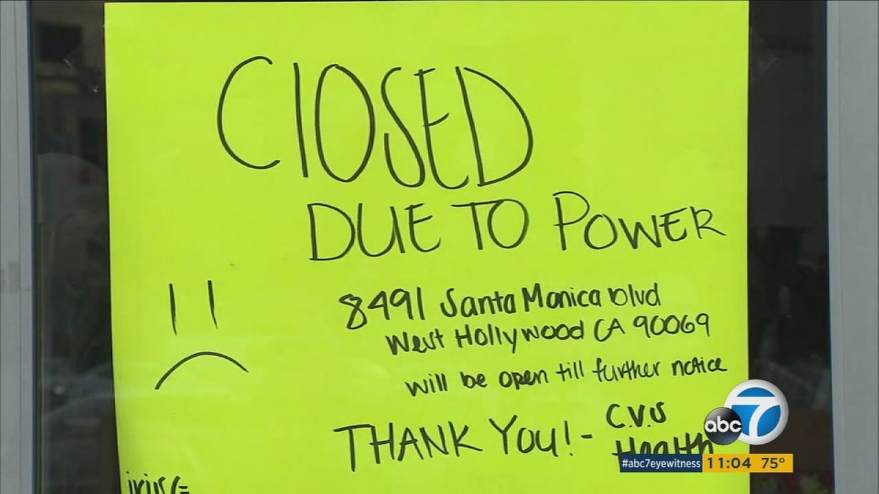 A sign shows a business closed because of a heat-related power outage in Los Angeles.