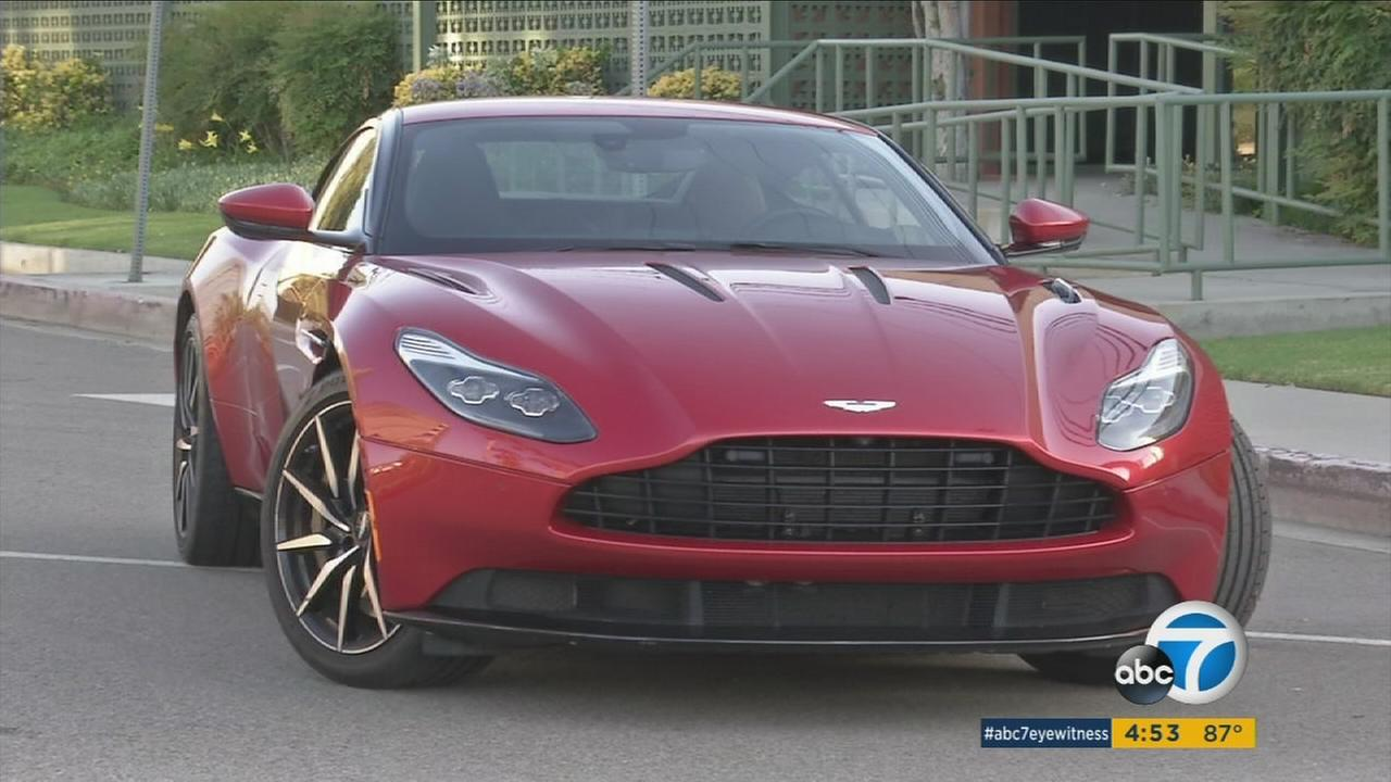 An Aston Martin DB11 is shown in a photo.