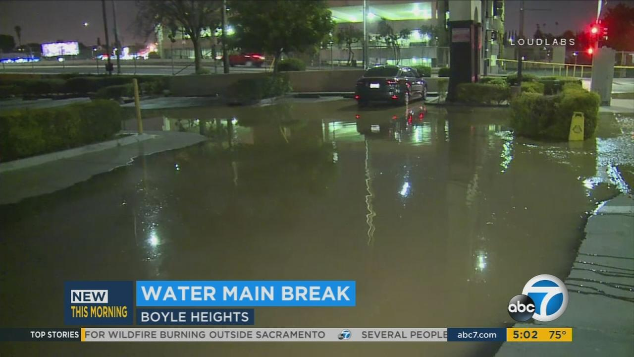 A parking lot in Boyle Heights was flooded after a water main break on Sunday, July 9, 2017.