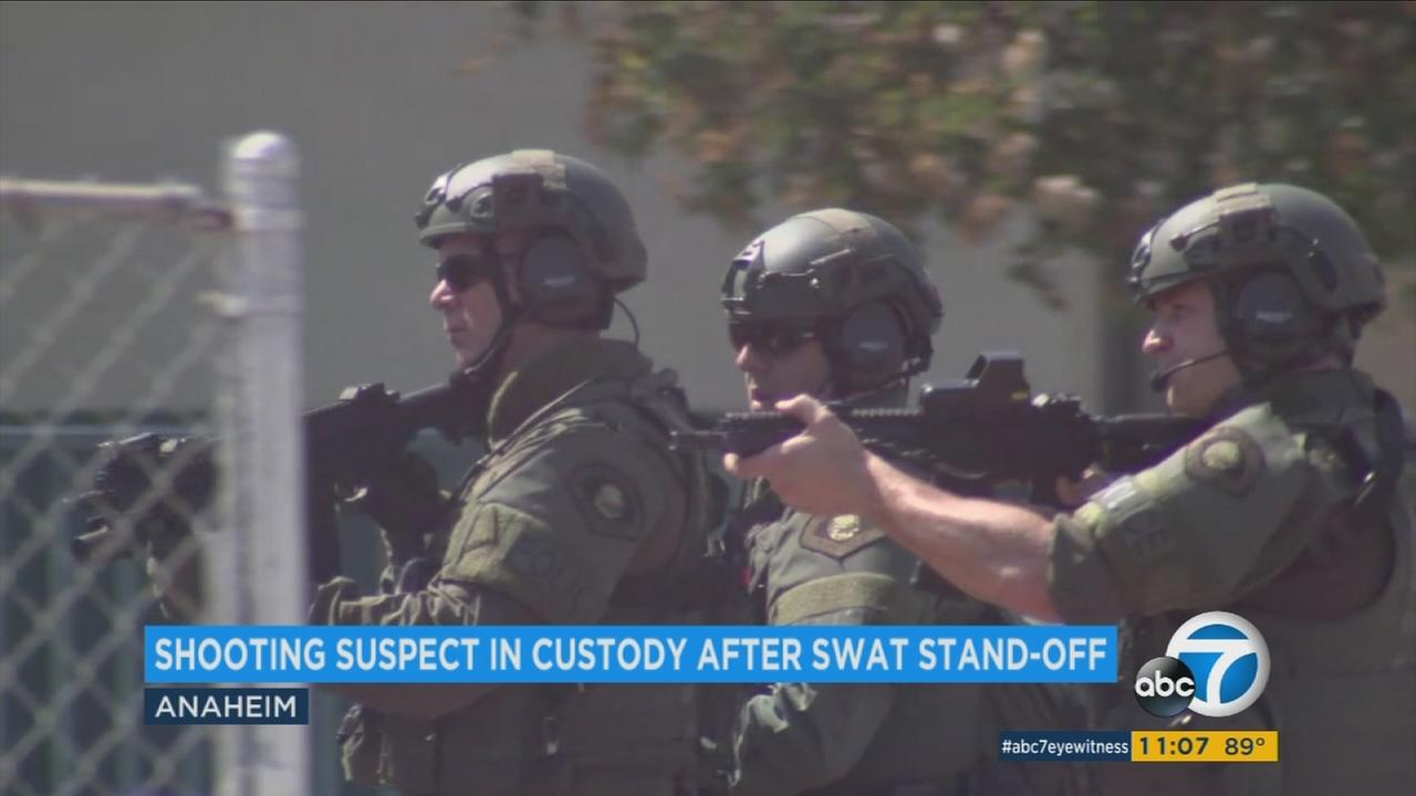 Armed SWAT officers are seen during a standoff at a home in Anaheim on Monday, July 10,l 2017.