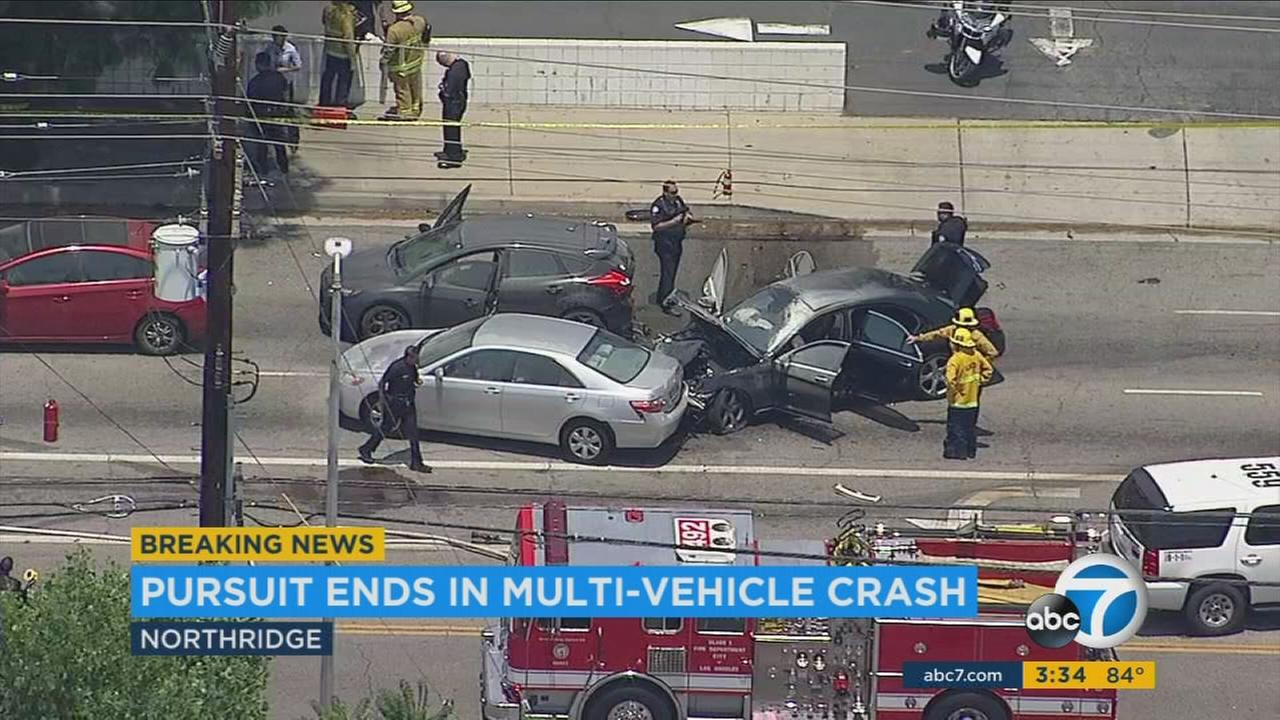 The Los Angeles Police Department arrested two people Monday after a car chase that ended in a fiery crash.