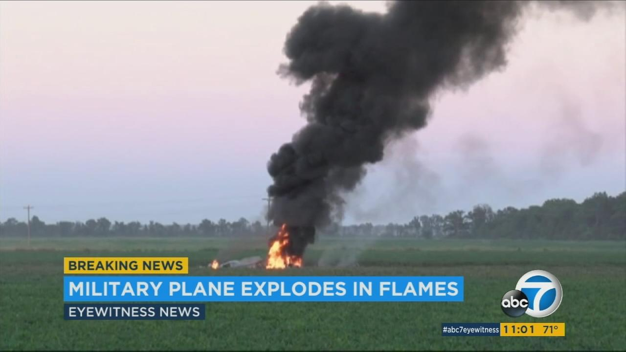 A fiery scene after a military plane crashed in rural Mississippi on Monday, July 10, 2017.