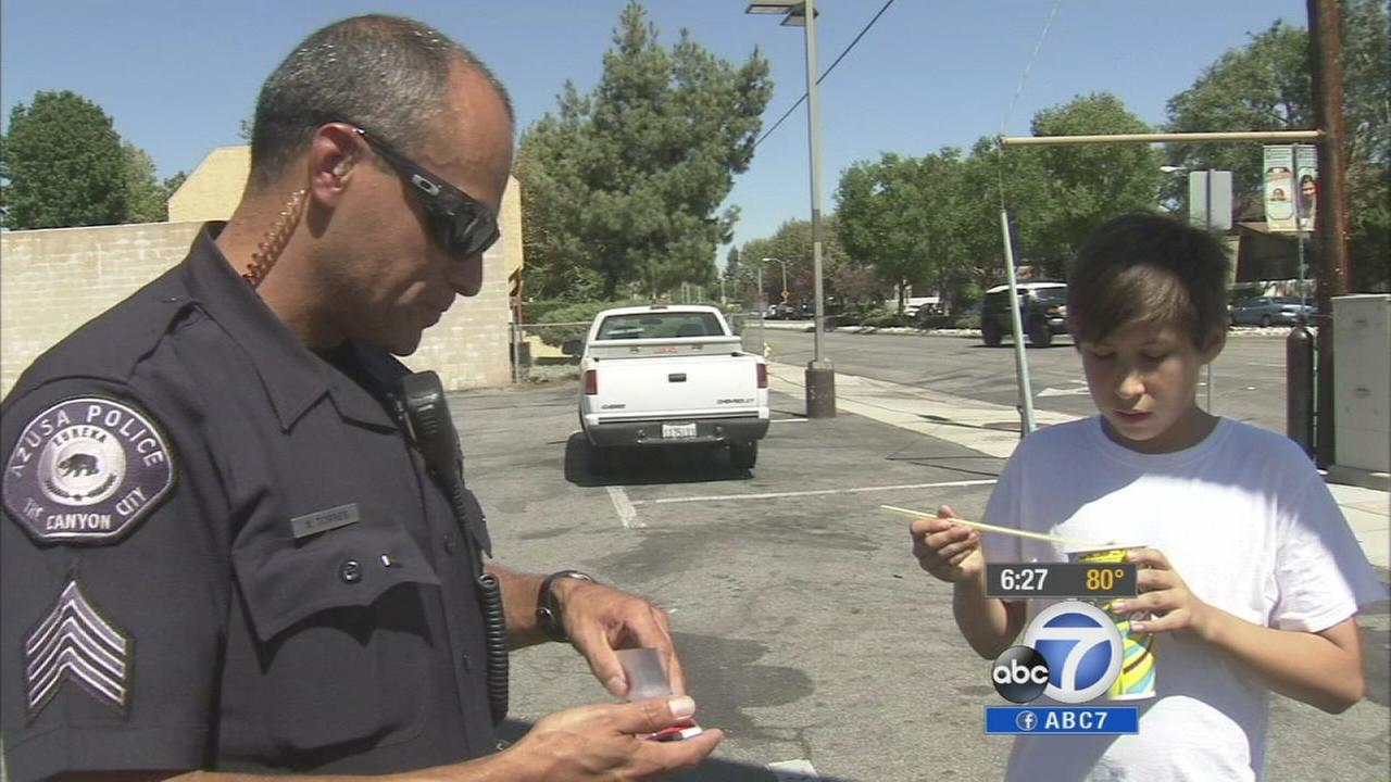 An Azusa police officer gives Daniel Torres a ticket for doing the right thing. He received a coupon for a free slurpee.