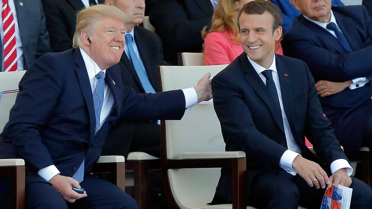 French President Emmanuel Macron and U.S. President Donald Trump attend the Bastille Day military parade on the Champs Elysees, in Paris, July 14, 2017. (AP Photo/Michel Euler)