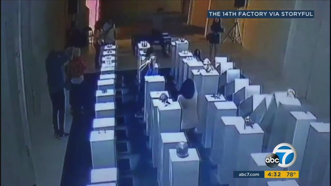A woman caused $200,000 worth of damage after knocking over an art display while taking a selfie at The 14th Factory in Los Angeles.