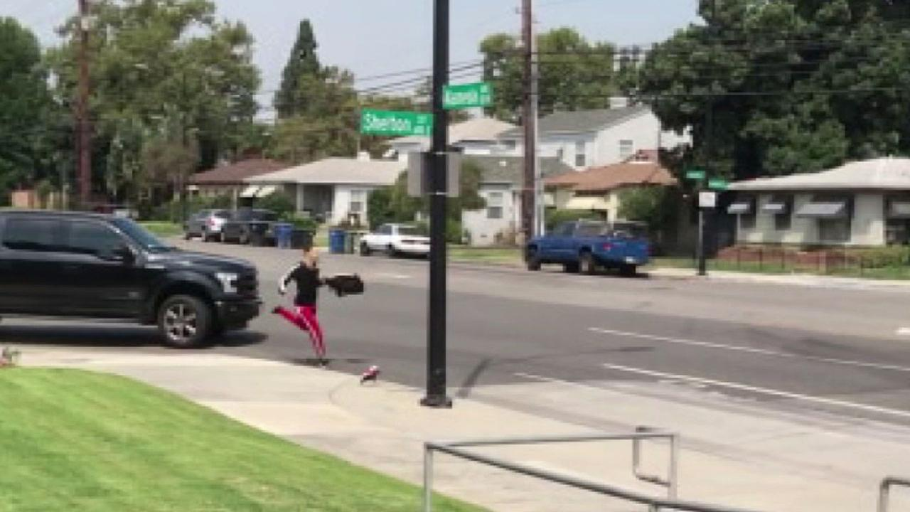 Video captures an alleged thief being struck by a truck in Burbank as he tries to run away with cash on Thursday, July 13, 2017.