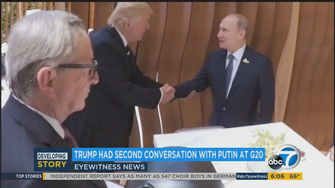 President Donald Trump is shown shaking hands with Russian President Vladimir Putin in Germany.