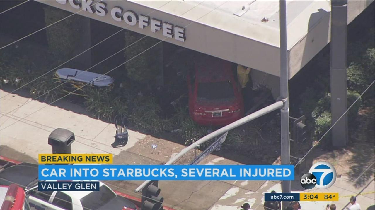 At least seven people were injured, three seriously, when a car careened into a Starbucks following a crash in Valley Glen.