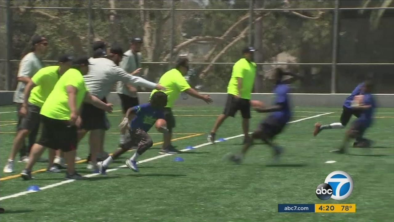 Los Angeles Rams players helped coach SoCal kids at a football camp run by the Garth Brooks Teammates for Kids foundation.