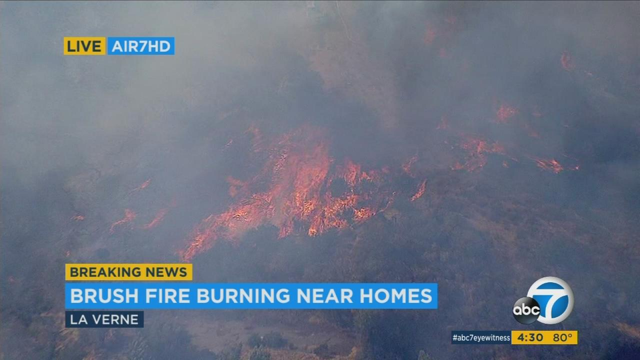 Firefighters battled a fast-moving brush fire in La Verne that was threatening homes.