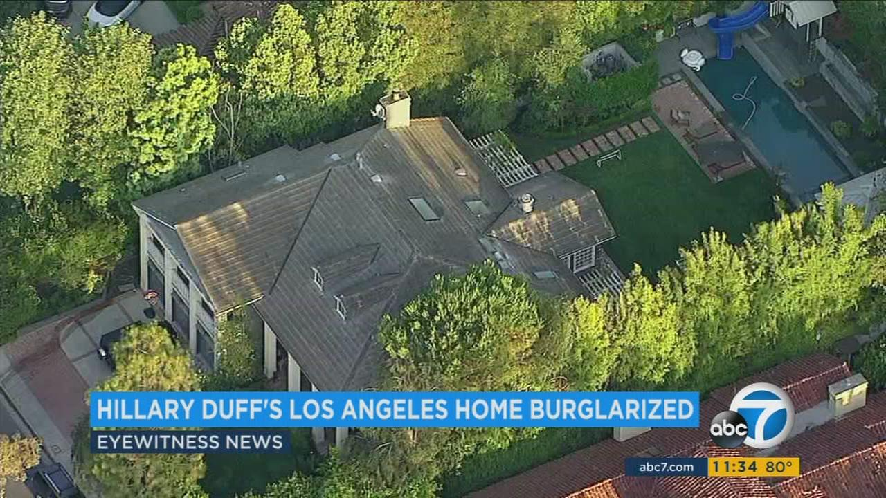 Actress and singer Hilary Duffs Beverly Hills home was burglarized while she was on vacation in Canada with her son last week, Los Angeles police have confirmed.