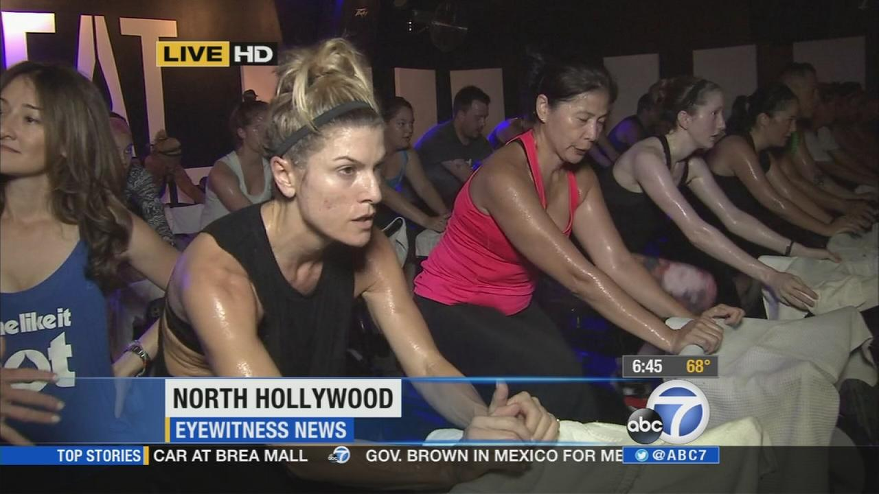People workout during a hot cycling class in North Hollywood on Monday, July 28, 2014.