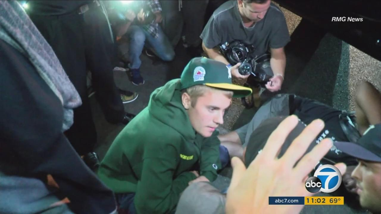 Justin Bieber remained at the scene after striking a photographer with his pickup truck in Beverly Hills on Wednesday, July 26, 2017.