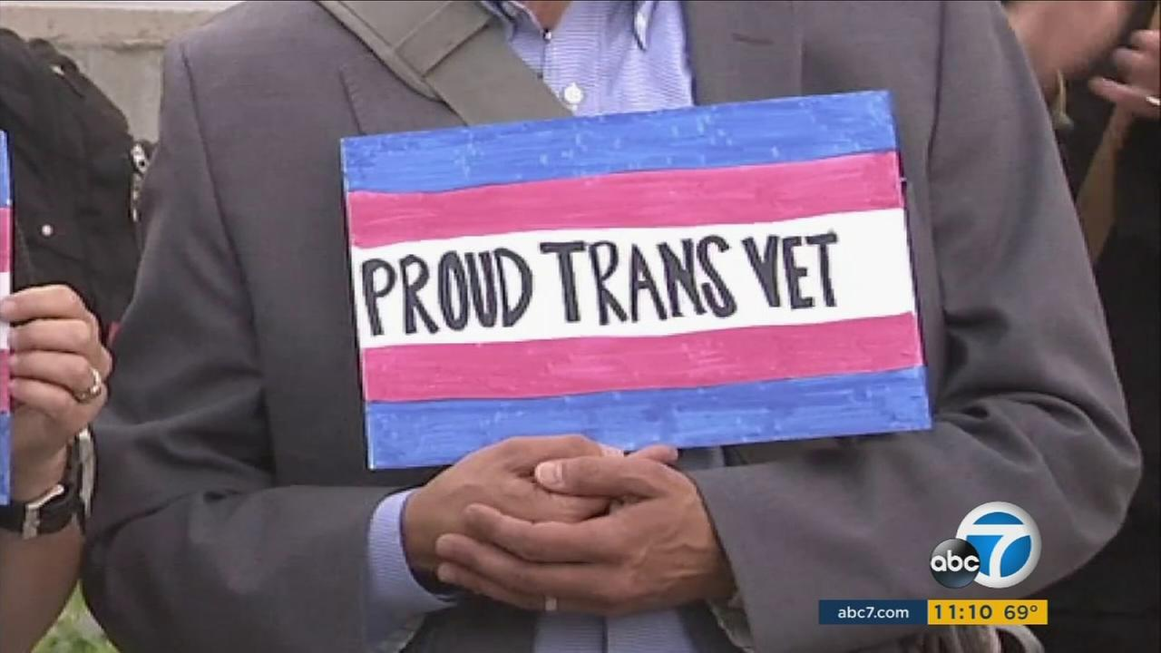 A transgender veteran holds a sign at the LGBTQ Center in Los Angeles during a discussion of Trumps recent military ban.