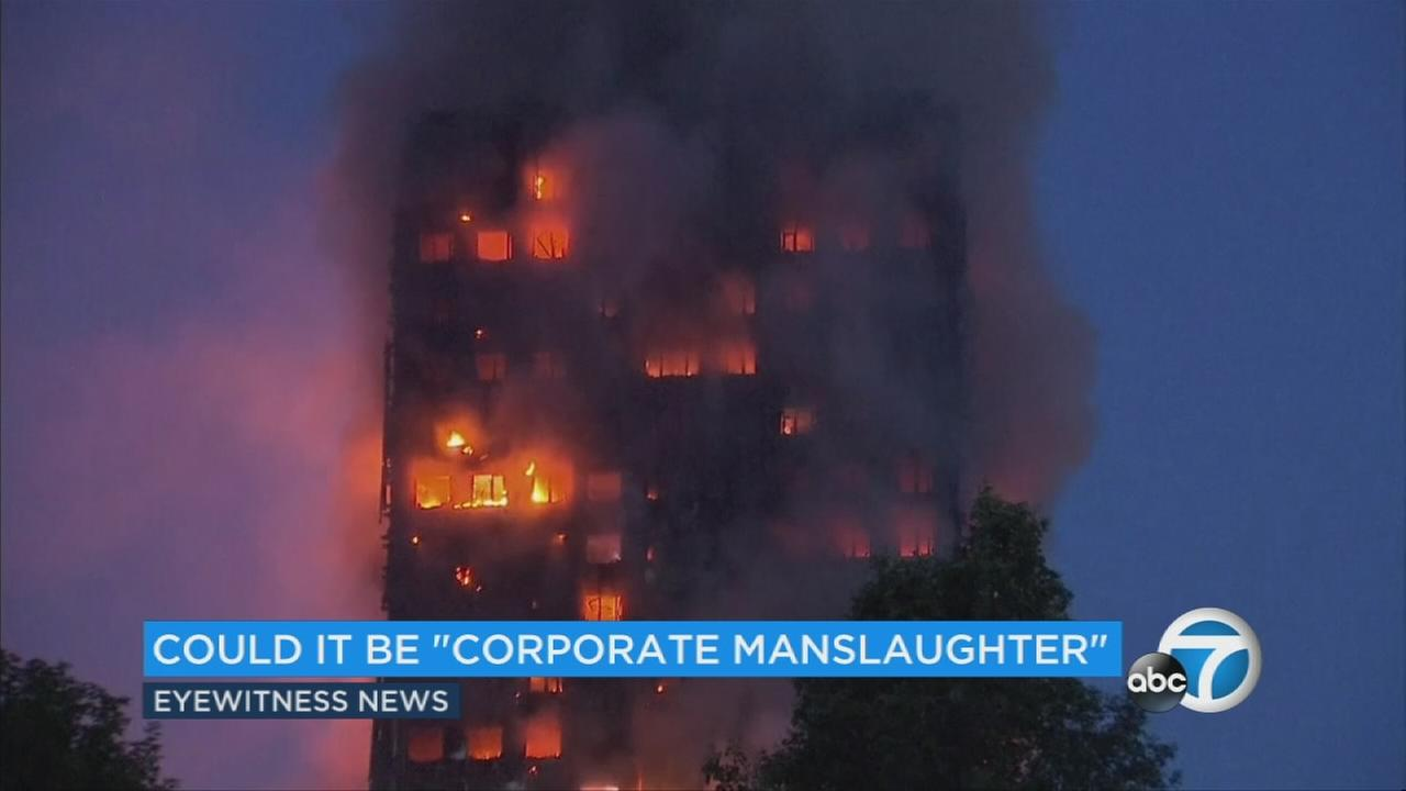 Smoke and flames rise from a building on fire in London, Wednesday, June 14, 2017.