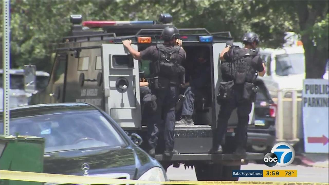 SWAT officers responded to a Hollywood motel for a shots fired call and eventually found the suspect dead inside.