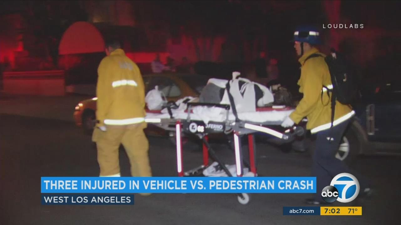 A person is transported after a vehicle struck two pedestrians in West Los Angeles on Sunday, July 30, 2017