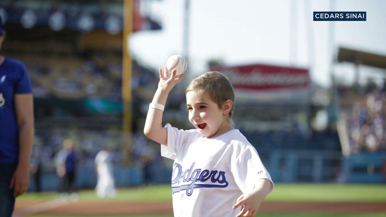 Elysa Shapiro, a 6-year-old girl fighting leukemia, threw the first pitch at Dodgers Stadium on Sunday, July 30, 2017.
