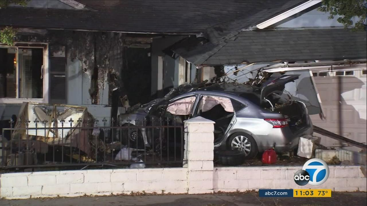 A car seen mangled next a burnt garage after an alleged DUI driver plowed into the Covina home on Monday, July 31, 2017.