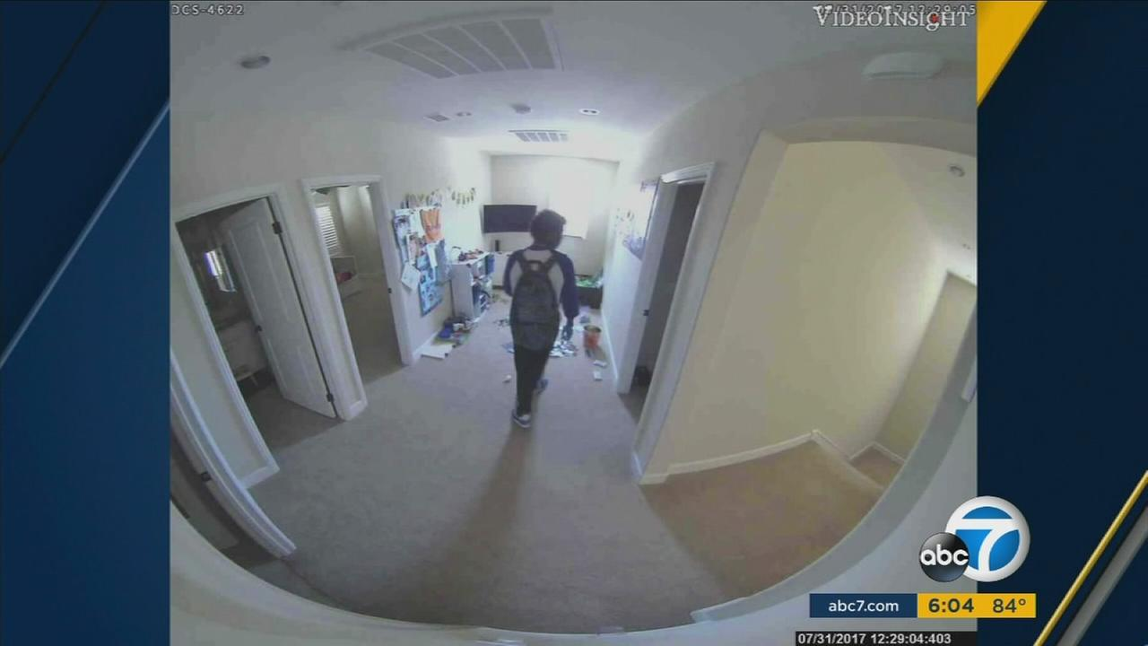 A suspect seen burglarizing an Irvine home before a young boy and babysitter walk inside.