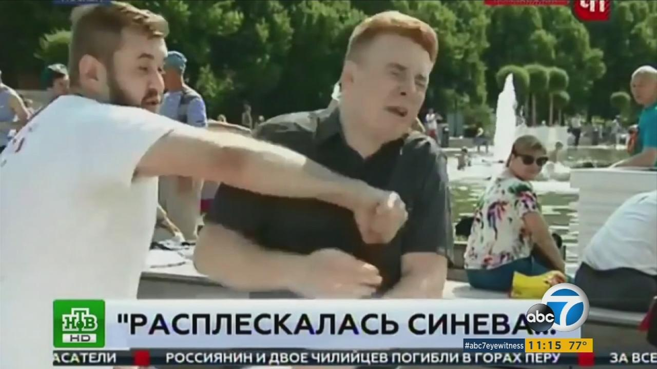 A reporter was caught on camera being punched in the face in the middle of a live take during a newscast in Russia.