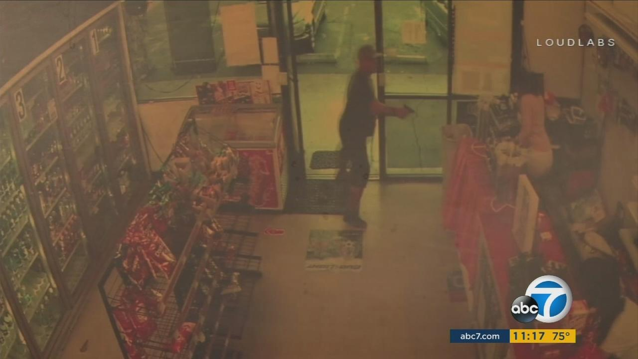 Surveillance video shows a shootout between a robbery suspect and a store clerk in Victorville.